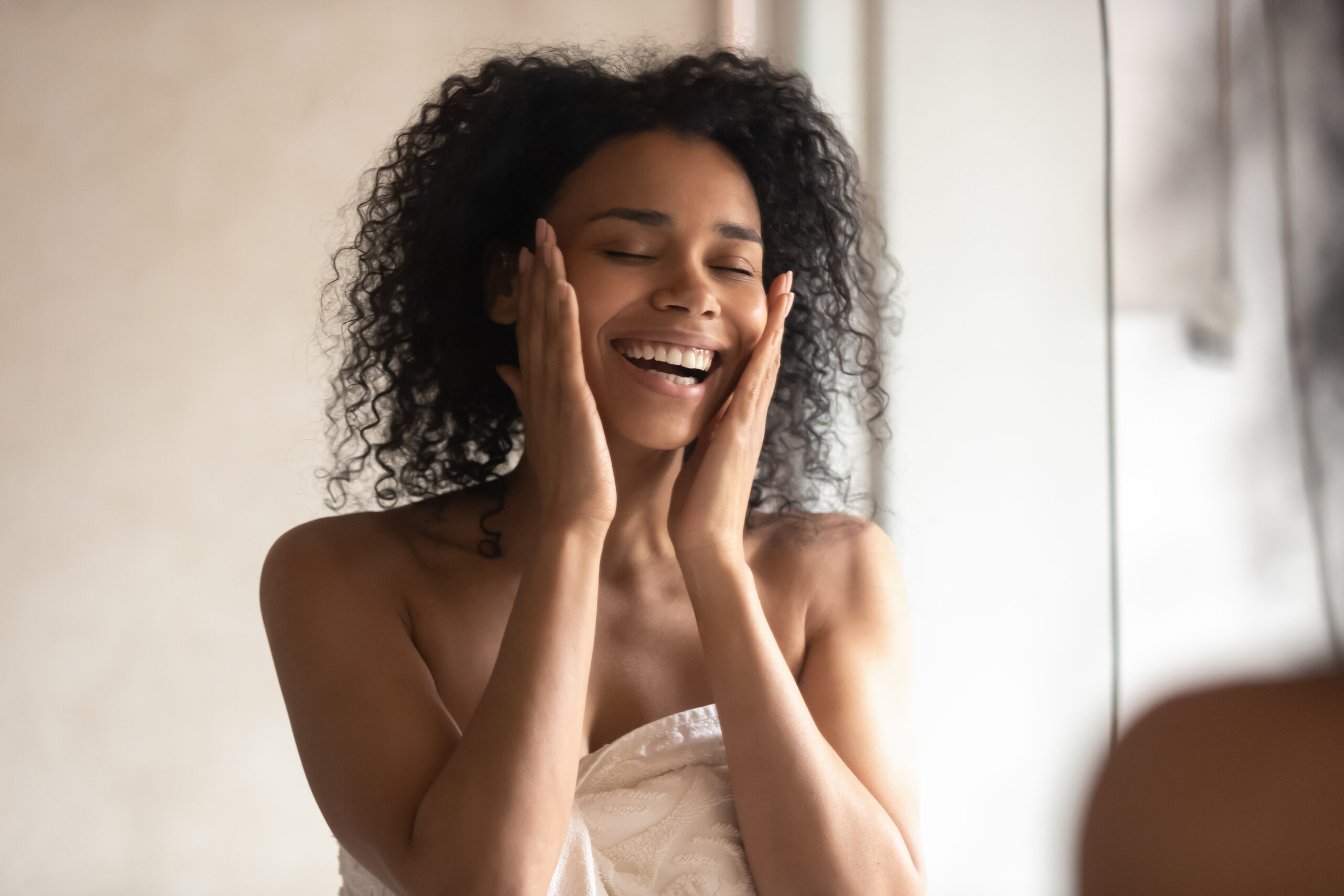 African American woman using Privai Gentle Mineral Toner