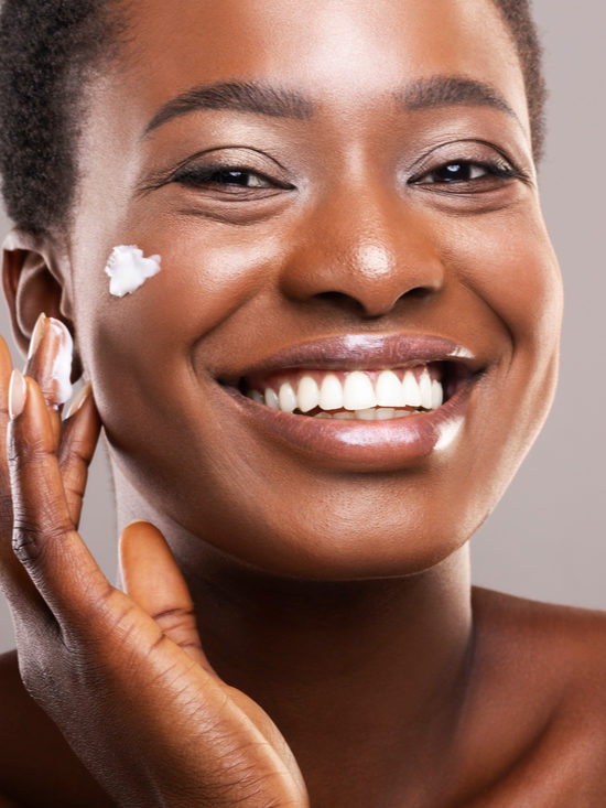 African American woman using matte moisturizer from Privai