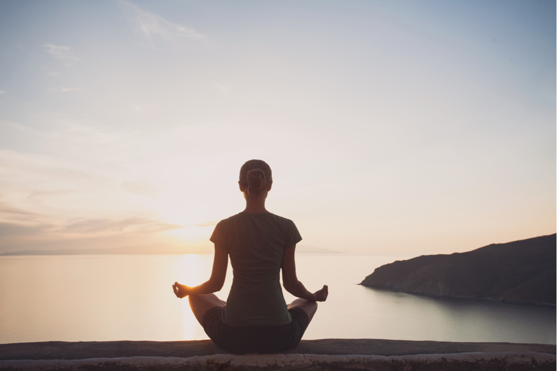 Meditating Woman on a dock
